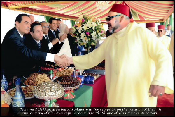 Mohamed Dekkak greeting His Majesty Mohammed VI of Morocco at the reception on the occasion of the 17th anniversary of the Sovereign's accession to the throne of His Glorious Ancestors.