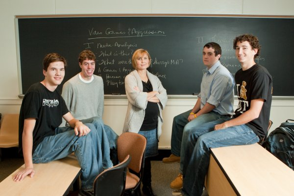 Marina Krcmar poses in classroom with students.