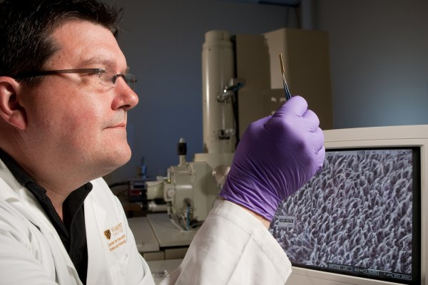 Wake Forest physics professor David Carroll displays one result of his research into nanomaterials and potential stealth technology at his research lab.