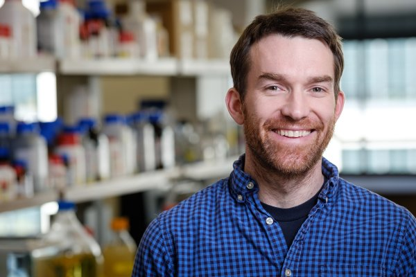 Wake Forest biology professor Matthew Fuxjager poses for a profile in his new lab in Wake Downtown